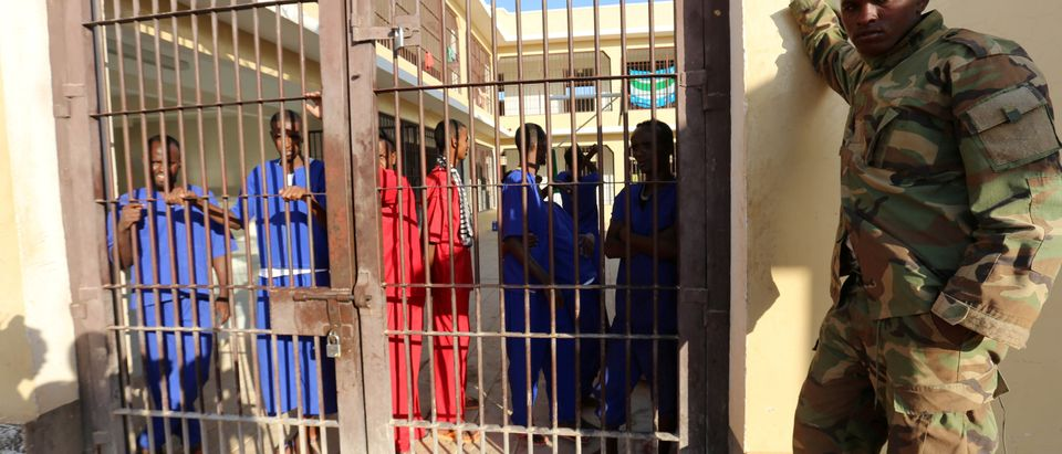 FILE PHOTO: Former Somali pirates stand behind bars in a yard at the Garowe prison in the Puntland region of northeastern Somalia