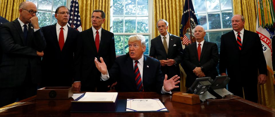 U.S. President Trump talks to reporters during bill signing ceremony at the White House in Washington