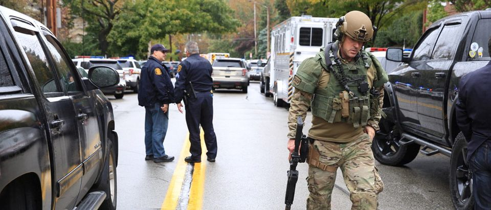 Police officers respond after a gunman opened fire at the Tree of Life synagogue in Pittsburgh Pennsylvania