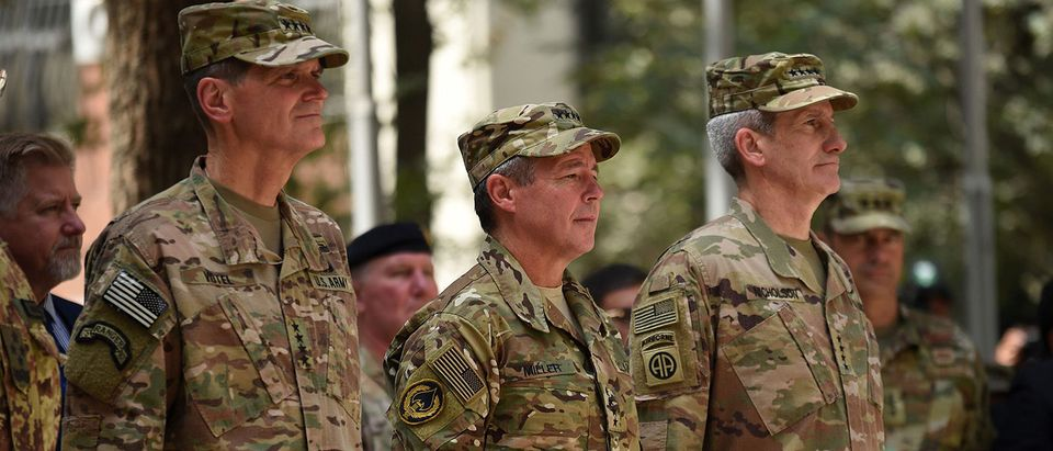 Incoming General Scott Miller (C), command of US and NATO forces in Afghanistan, outgoing U.S. Army General John Nicholson (R) and U.S. army General Votel (L) look on during a change of command ceremony at Resolute Support in Kabul on September 2, 2018. - General Scott Miller took command of US and NATO forces in Afghanistan on September 2, as worsening violence erodes hopes for peace in the war-torn country. WAKIL KOHSAR/AFP/Getty Images