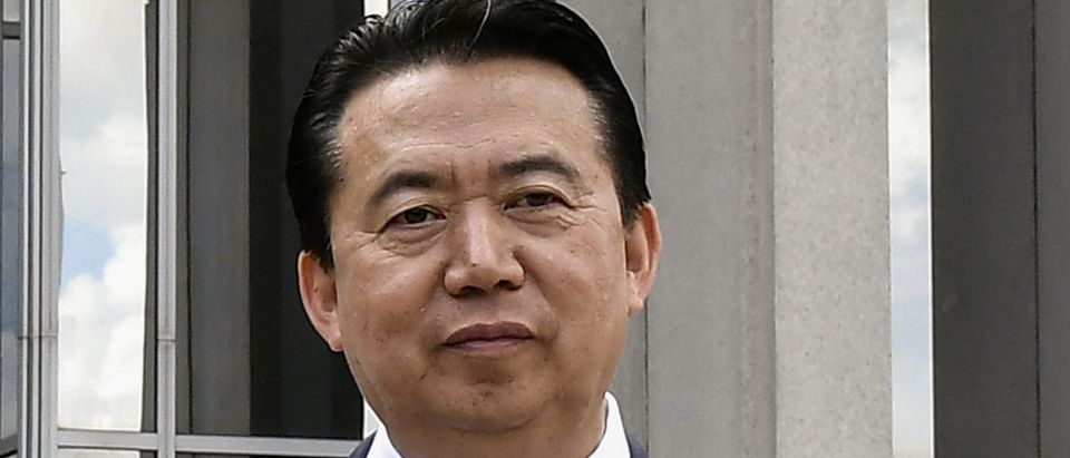 INTERPOL President Meng Hongwei poses during a visit to the headquarters of International Police Organisation in Lyon, France, May 8, 2018. Picture taken May 8, 2018. Jeff Pachoud/Pool via Reuters - RC12F835FFF0