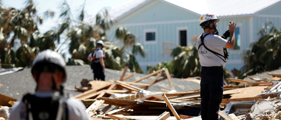 A search and rescue team works in homes destroyed by Hurricane Michael in Mexico Beach
