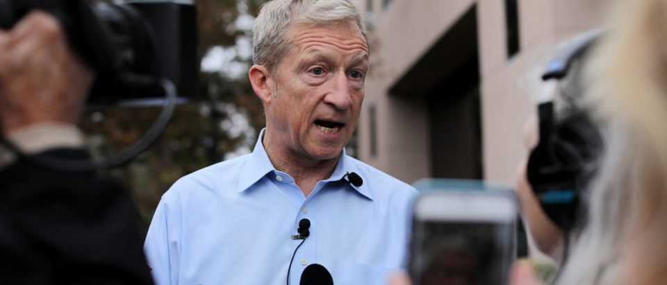 Political and climate activist Tom Steyer speaks to the media while attending a protest against U.S. President Donald Trump and Republican congressman Darrell Issa (R-Vista) outside Issa's office in Vista