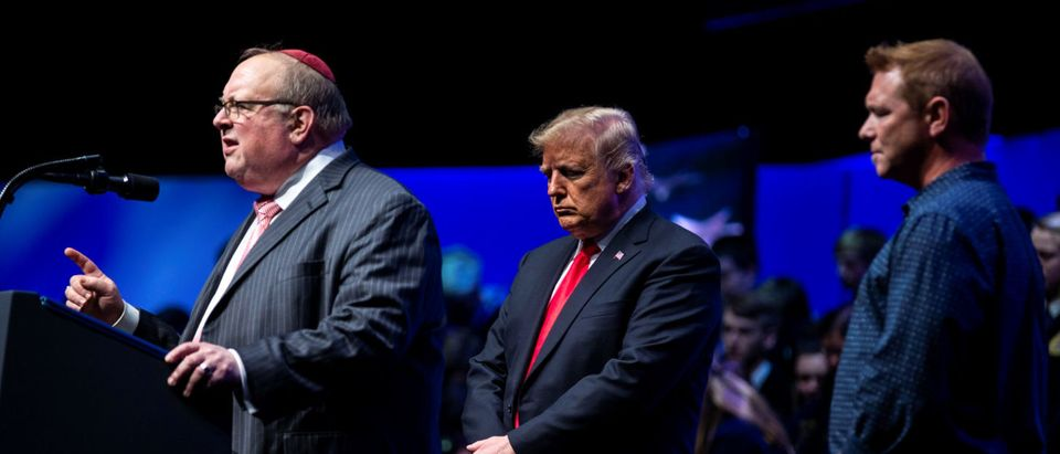 Rabbi Benjamin Sendrow leads a prayer alongside U.S. President Donald Trump and Pastor Thom O'Leary, at the 91st Annual Future Farmers of America Convention and Expo, in Indianapolis, IN, U.S., October 27, 2018. REUTERS/Al Drago