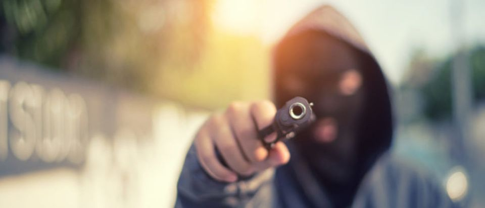 Pictured is a young man with a pistol. (Photo: Getty Images/Boonchai Wedmakawand)