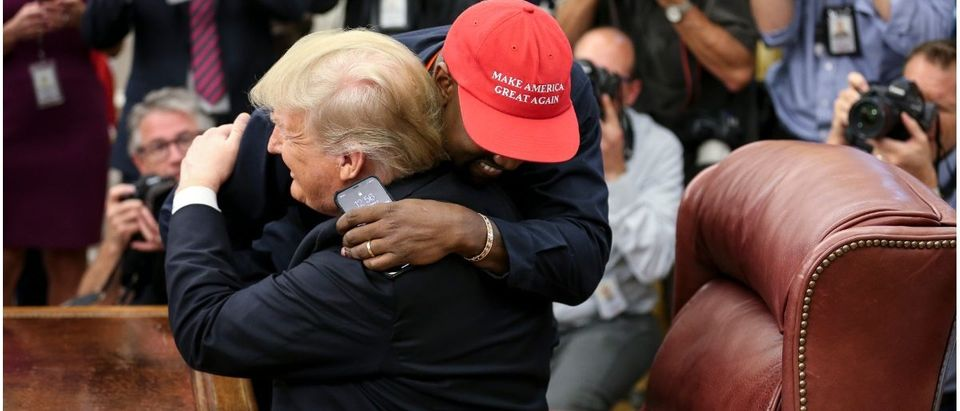 Rapper Kanye West hugs U.S. President Donald Trump during a meeting in the Oval office of the White House on October 11, 2018 in Washington, DC. (Oliver Contreras - Pool/Getty Images)