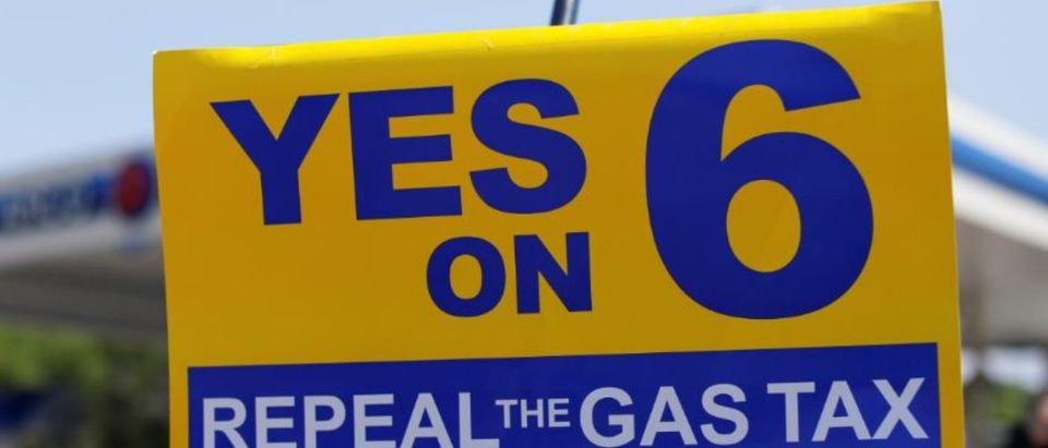 A California Proposition 6 six sign is shown as the growing movement to repeal a state gas tax holds an event at an Arco Gas station in San Diego, California, U.S. July 11, 2018. REUTERS/Mike Blake