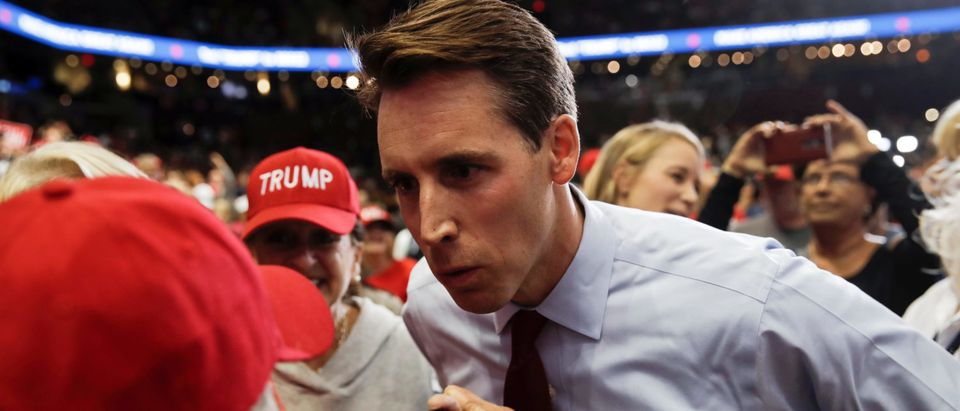 Missouri Attorney General and Republican U.S. Senate candidate Josh Hawley greets supporters of U.S. President Donald Trump at a campaign rally in Springfield, Missouri, U.S., September 21, 2018. Picture taken September 21, 2018. REUTERS/Mike Segar