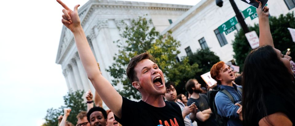 Demonstrators protest in the street behind the U.S. Supreme Court building as they wait for Justice Brett Kavanaugh to depart after he was sworn in as an Associate Justice of the court in ceremonies at the court on Capitol Hill in Washington, U.S., October 6, 2018. REUTERS/Carlos Barria
