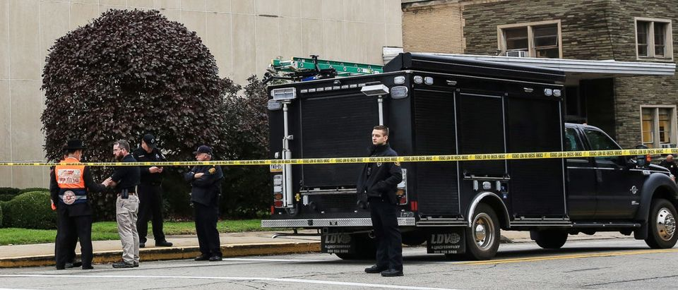 Police officers guard the Tree of Life synagogue following shooting at the synagogue in Pittsburgh Pennsylvania