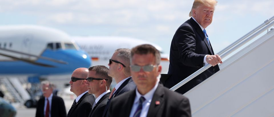 Secret Service Agents stand guard as U.S. President Donald Trump boards Air Force One to depart for travel to Singapore from the Canadian Forces Base Bagotville, Quebec, Canada, June 9, 2018. REUTERS/Jonathan Ernst