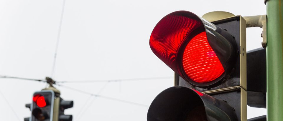 A red light goes on at an intersection. Shutterstock image via user Lisa S.