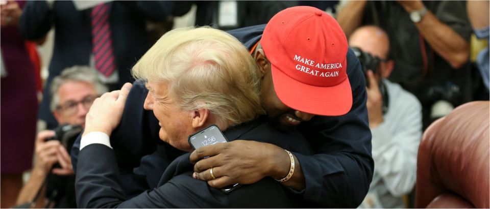 WASHINGTON, DC - OCTOBER 11: (AFP OUT) U.S. President Donald Trump hugs rapper Kanye West during a meeting in the Oval office of the White House on October 11, 2018 in Washington, DC. (Photo by Oliver Contreras - Pool/Getty Images)