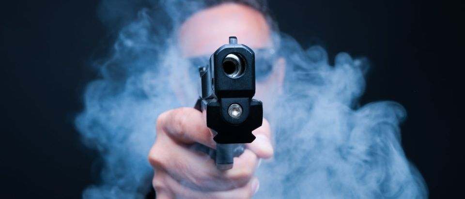 A gunman (Shutterstock/Pop Paul-Catalin)