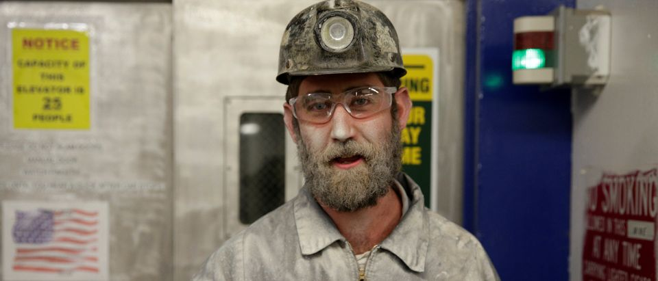Brian Tingler, 38, stands covered in dust after his shift at the American Energy Corporation Century Mine in Beallsville, Ohio