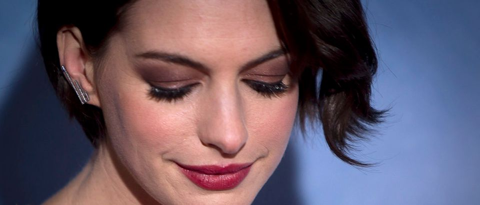 "Actress Anne Hathaway arrives for the premiere of her film ""Interstellar"" in New York November 3, 2014. REUTERS/Carlo Allegri"