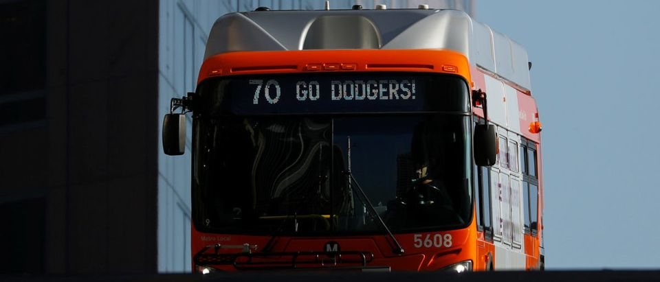 "A city bus scrolls ""Go Dodgers"" as it supports the city's baseball team in the World Series against the Boston Red Sox during its route through downtown Los Angeles, California, U.S., Oct. 24, 2018. REUTERS/Mike Blake"