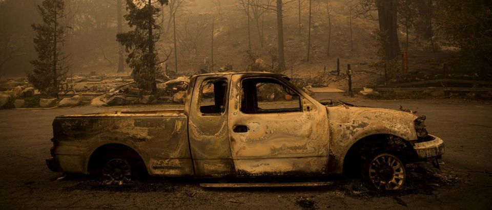 """A burned trucks sits next to the remains of the Kings Canyon Lodge, burnt by the so-called """"Rough Fire"""" in the Sequoia National Forest, California, August 21, 2015. In California, suffering its worst drought on record, about 2,500 people were forced to flee Christian camps east of Fresno at Hume Lake as the so-called Rough Fire crossed Highway 180, officials said. REUTERS/Max Whittaker"""