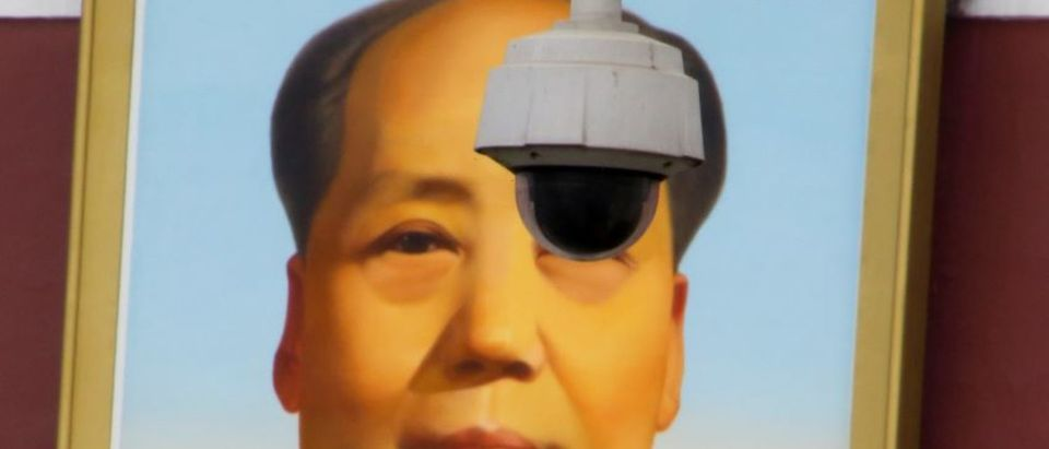 A security camera overlooks Tiananmen Square in front of a portrait of the late Chinese Chairman Mao Zedong in Beijing, China March 6, 2018. Picture taken March 6, 2018. REUTERS/Thomas Peter