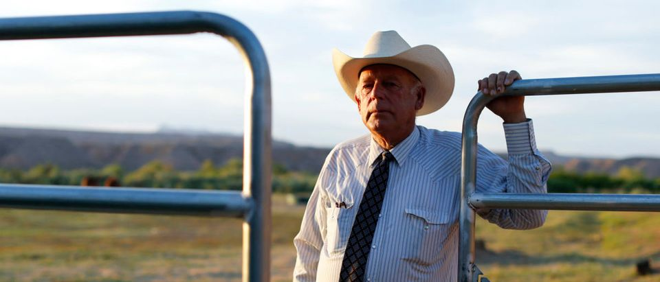 Rancher Cliven Bundy stands near a metal gate on his 160 acre ranch in Bunkerville, Nevada May 3, 2014. USA-RANCHERS/NEVADA-TORTOISES/REUTERS/Mike Blake