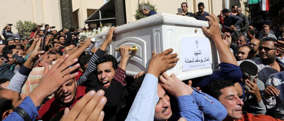 Mourners carry a coffin during the funeral of Coptic Christians who were killed in an attack, in Minya, Egypt November 3, 2018. REUTERS/Mohamed Abd El Ghany