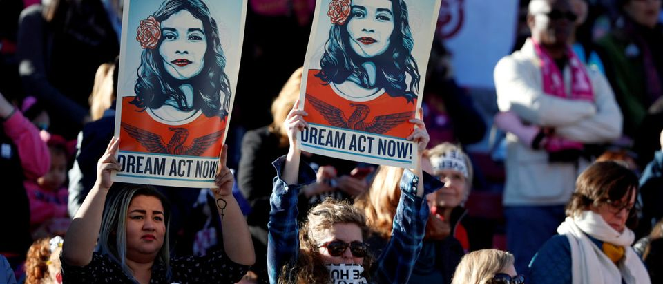 Supporters of Deferred Action for Childhood Arrivals (DACA) hold signs during the Women's March rally in Las Vegas, Nevada, U.S. January 21, 2018. REUTERS/Steve Marcus