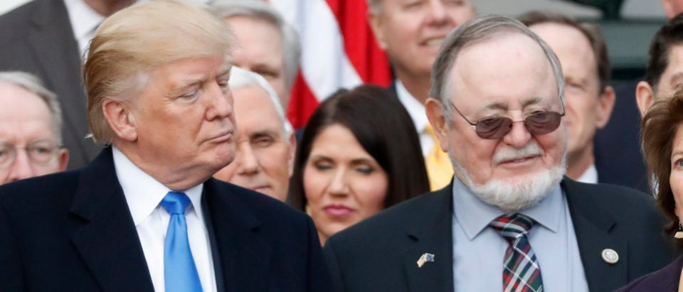 U.S. President Donald Trump stands with Alaska Republican Rep. Don Young while celebrating with congressional Republicans after the U.S. Congress passed sweeping tax overhaul legislation on the South Lawn of the White House in Washington, U.S., Dec. 20, 2017. REUTERS/Jonathan Ernst