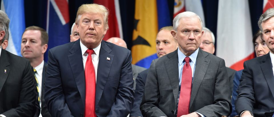 President Donald Trump sits with Attorney General Jeff Sessions on December 15, 2017 in Quantico, Virginia, before participating in the FBI National Academy graduation ceremony. (Photo: NICHOLAS KAMM/AFP/Getty Images)