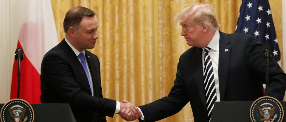 U.S. President Donald Trump greets Poland's President Andrzej Duda at the start of a joint news conference in the East Room of the White House in Washington, U.S., September 18, 2018. REUTERS/Kevin Lamarque