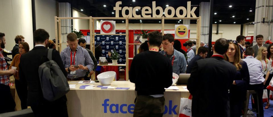 People stop at the Facebook booth at the Conservative Political Action Conference (CPAC) at National Harbor, Maryland