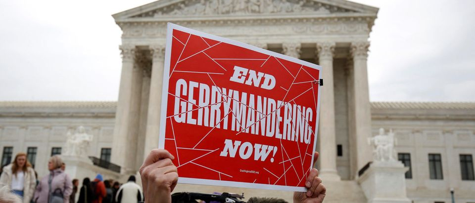 Demonstrators rally in front of the Supreme court before oral arguments on Benisek v. Lamone, a redistricting case on whether Democratic lawmakers in Maryland unlawfully drew a congressional district in a way that would prevent a Republican candidate from winning, in Washington March 28, 2018. REUTERS/Joshua Roberts