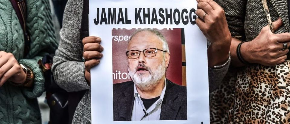 """A woman holds a portrait of missing journalist and Riyadh critic Jamal Khashoggi reading """"Jamal Khashoggi is missing since October 2"""" during a demonstration in front of the Saudi Arabian consulate on Oct. 9, 2018 in Istanbul. (Photo by OZAN KOSE / AFP)"""