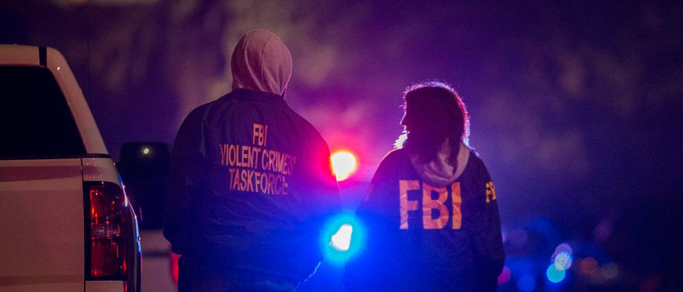 F.B.I. agents monitor the scene near the Borderline Bar and Grill, where a mass shooting occurred, on November 8, 2018 in Thousand Oaks, California. David McNew/Getty Images