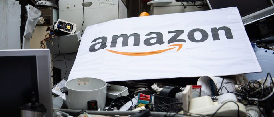 A placard with the logo of US online retailer Amazon is seen on top of trashed appliances that have been dumped by activists of French NGOs 'Les Amis de la Terre' (Friends of the Earth) and ANV Cop21 in front of the French headquarters of Amazon on November 23, 2018 in Clichy, northwest of Paris, during a protest against the company and on the first day of the Black Friday sales. JULIE SEBADELHA/AFP/Getty Images