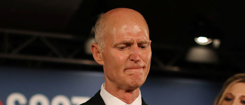 Florida Gov. Rick Scott pauses as he becomes emotional while speaking as he stands with his wife, Ann Scott, (L) and daughter Alison Guimard (R) during his election night party at the LaPlaya Beach & Golf Resort on November 06, 2018 in Naples, Florida. (Photo by Joe Raedle/Getty Images)