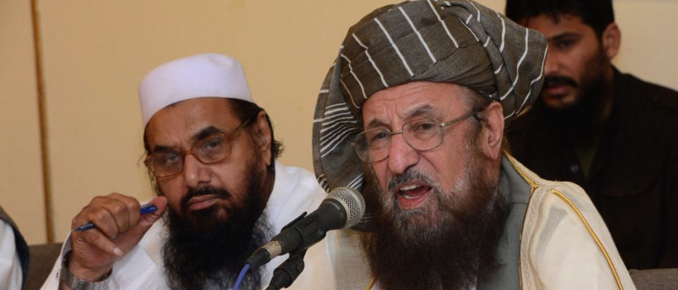 Pakistani Islamist groups and Defence of Pakistan coalition leader Hafiz Muhammad Saeed (R) addresses the coalition meeting in Rawalpindi on September 11, 2012, as coalition leader Hafiz Muhammad Saeed listens . Defense of Pakistan coalition chairman Maulana Samiul Haq criticised the US led international military action in 2001 in Afghanistan in a meeting which also discussed the country current political issues. AFP PHOTO AFPP HOTO/Farooq NAEEM / Getty Images