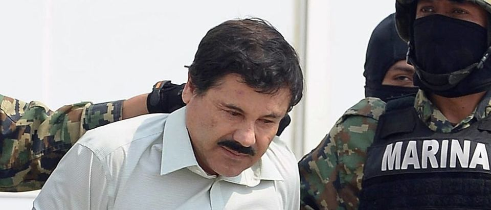 "Mexican drug trafficker Joaquin Guzman Loera aka ""el Chapo Guzman,"" is escorted by marines as he is presented to the press on February 22, 2014 in Mexico City. ALFREDO ESTRELLA/AFP/Getty Images"