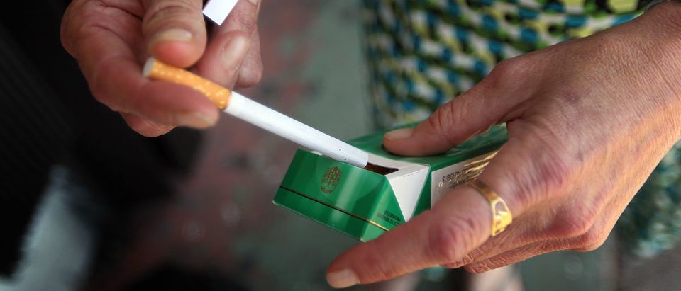 Brenda Wisehart smokes a menthol cigarette in front of a Quick Stop store on March 30, 2010 in Miami, Florida. Joe Raedle/Getty Images