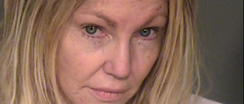 In this handout photo provided by the Ventura County Sheriffs Office, actress Heather Locklear is seen in a police booking photo after her arrest on charges of suspicion of domestic battery and assaulting a peace officer February 25, 2018 in Ventura, California. Police were called to Locklears Thousand Oaks home after reports of a domestic battery. Locklear was released after posting bail. (Photo by Ventura County Sheriffs Office via Getty Images)
