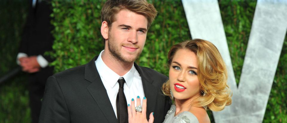 Actor Liam Hemsworth(L) and actress/singer Miley Cyrus arrive at the 2012 Vanity Fair Oscar Party hosted by Graydon Carter at Sunset Tower on February 26, 2012 in West Hollywood, California. (Photo by Alberto E. Rodriguez/Getty Images)