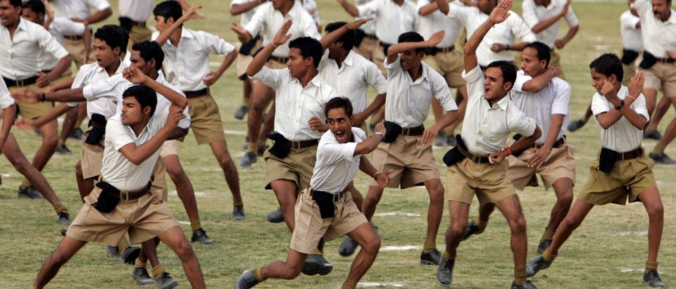 Volunteers of RSS take part in a drill during a training camp in Bhopal