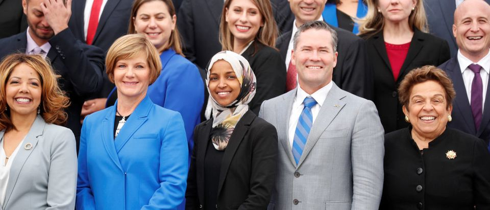Democratic Rep.-elect Ilhan Omar (C) of Minnesota, one of the first Muslim women elected to Congress, poses in the front row with other incoming newly elected members of the U.S. House of Representatives on Capitol Hill in Washington, U.S., Nov.14, 2018. REUTERS/Kevin Lamarque