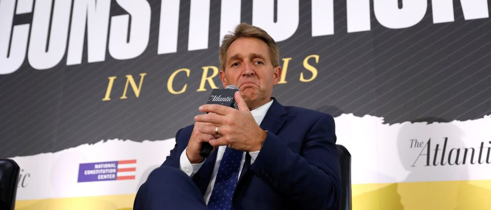 """U.S. Sen. Jeff Flake takes part in a discussion """"Can our Democracy Survive?"""" at The Atlantic and the Aspen Institute's 2018 Atlantic Festival in Washington, U.S., Oct. 2, 2018. REUTERS/Kevin"""