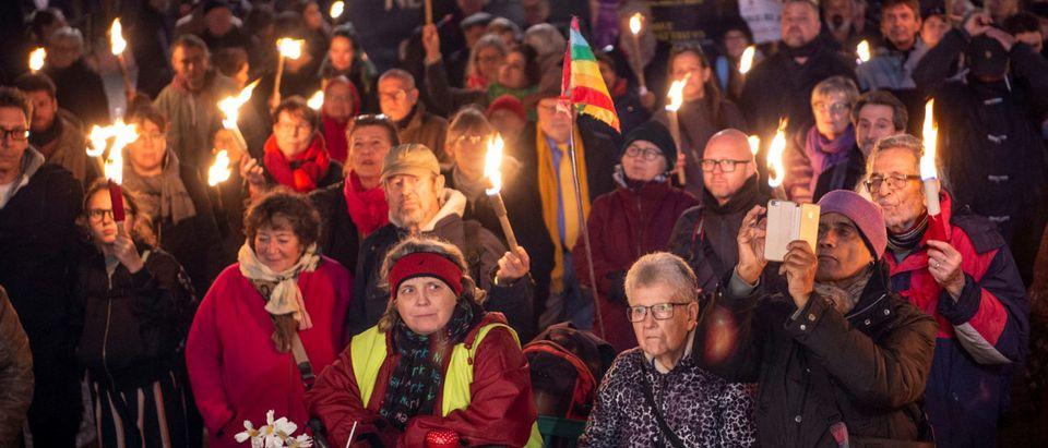 People attend the 80th anniversary of the Kristallnacht or Night of the broken glasses at Kultorvet in Copenhagen, Denmark November 9, 2018. Nils Meilvang/Ritzau Scanpix via REUTERS