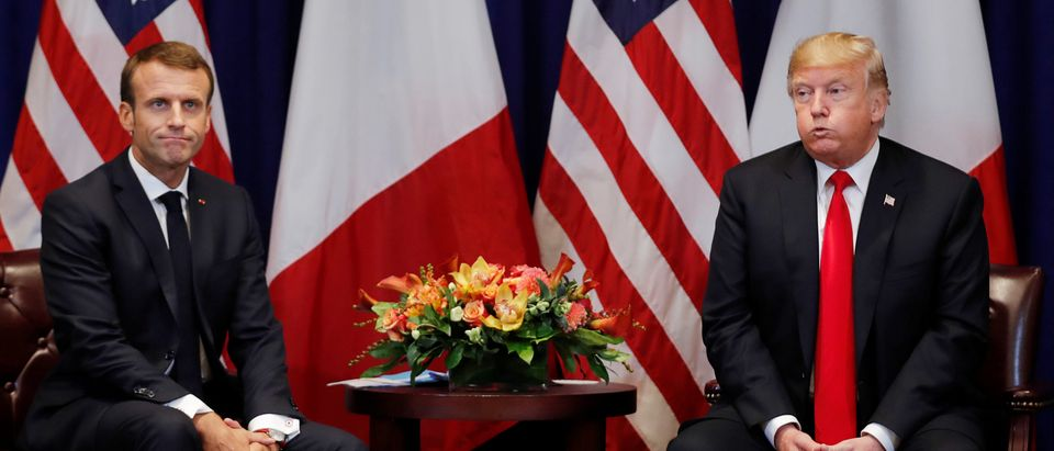 France's President Macron and U.S. President Trump both react as they hold a bilateral meeting on sidelines of UN General Assembly in New York