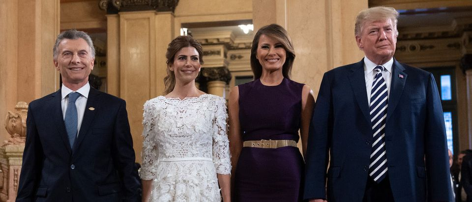 US President Donald Trump (R) and her wife US First Lady Melania Trump (2-R) pose with Argentina's President Mauricio Macri (L) and his wife Argentina's First Lady Juliana Awada, prior to a gala at the Colon Theater in Buenos Aires, on November 30, 2018 in the sidelines of the G20 Leader's Summit. (Photo credit: SAUL LOEB/AFP/Getty Images)