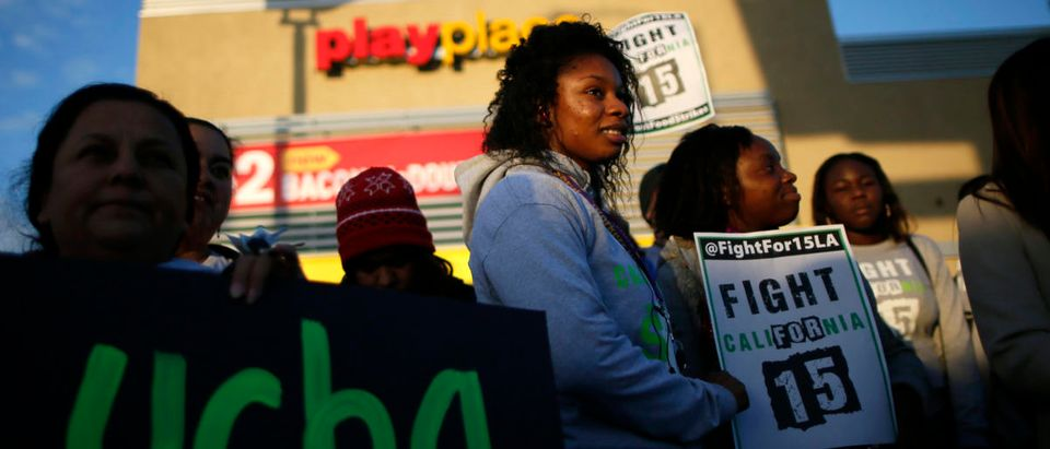 Protesters gather outside McDonald's in Los Angeles, California, December 5, 2013. Organizers say fast food workers will strike in 100 U.S. cities, and there will be protests in 100 more, to fight for $15 an hour wages and the right to form a union. REUTERS/Lucy Nicholson