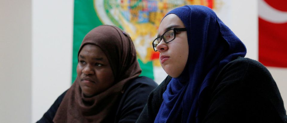 Tenth grade students Ayia Elsadig (L) and Sarah Sendian listen as Nadeem Mazen, Cambridge city councillor, Muslim and founder of JetPAC, speaks to their AP Government class at Al-Noor Islamic high school in Mansfield