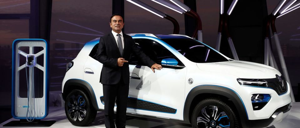 "Carlos Ghosn, Chairman and CEO of the Renault-Nissan Alliance, poses with an electric show car called Renault K-ZE after its launch during an event entitled ""The Electrical Revolution: The Story Continues"" prior the opening of the Paris auto show in Paris, France October 1, 2018. REUTERS/Benoit Tessier"