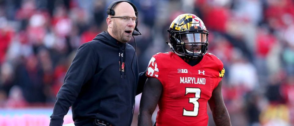 COLLEGE PARK, MD - NOVEMBER 17: Interim head coach Matt Canada of the Maryland Terrapins speaks to Tyrrell Pigrome #3 of the Maryland Terrapins during the second half against the Ohio State Buckeyes at Capital One Field on November 17, 2018 in College Park, Maryland. (Photo by Will Newton/Getty Images)